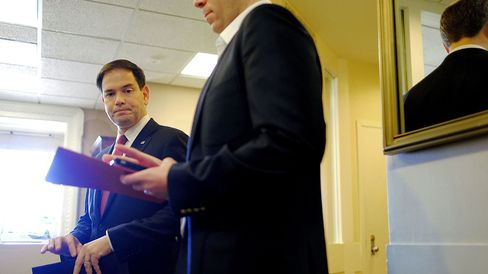 Sen. Marco Rubio (R-FL) talks to aides before speaking on U.S. President Barack Obama's announcement about revising policies on U.S.-Cuba relations on December 17, 2014 in Washington, DC.