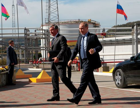 Russia, where Vladimir Putin confidant Igor Sechin, left, is chairman of state-controlled oil company Rosneft, saw the ruble decline almost in unison with the price of crude.