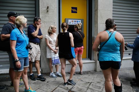 People wait in line at an automated teller machine (ATM) at a Piraeus Bank SA bank branch in Athens, Greece, on Monday, June 29, 2015.