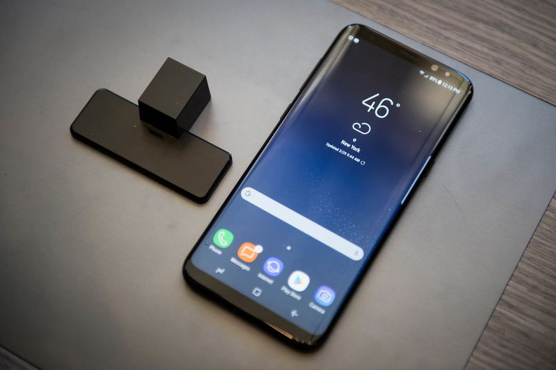 The Samsung Electronics Co. Galaxy S8+ smartphone is displayed during the Samsung Unpacked product launch event in New York, U.S., on Wednesday, March 29, 2017. Samsung Electronics Co. packed the Galaxy S8 smartphone with a plethora of new features: taller, curved screens, encrypted facial recognition, deeper display colors, system-wide voice control and the ability to turn into a desktop computer. Photographer: Mark Kauzlarich/Bloomberg