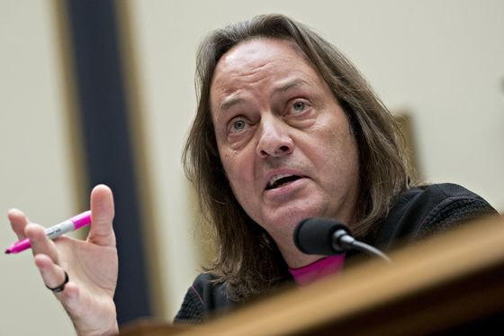 T-Mobile's Legere Fends Off Trump Hotel Criticism From Democrats