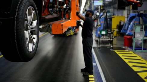 An employee attaches wheels to a Bayerische Motoren Werke AG (BMW) vehicle on the assembly line at the BMW Manufacturing Co. assembly plant in Greer, South Carolina.