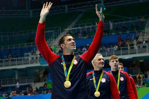 1470804111_phelps swimming 21 gold