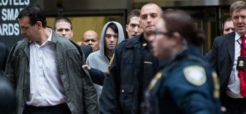 Martin Shkreli, chief executive officer of Turing Pharmaceuticals LLC, center, and attorney Evan Greebel, left, exit federal court in New York, U.S., on Thursday, Dec. 17, 2015. Shkreli was arrested on alleged securities fraud related to Retrophin Inc., a biotech firm he founded in 2011. Greebel is accused of conspiring with Shkreli in part of the scheme.