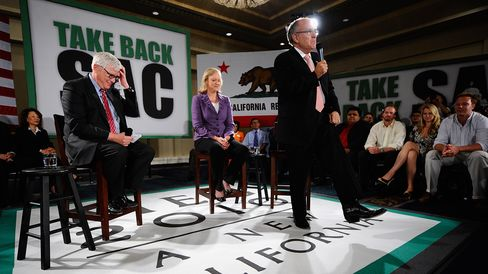 Radio talk show host Hugh Hewitt (left) appears with former New York City Mayor Rudy Giuliani and then-gubernatorial candidate Meg Whitman on Oct. 10, 2010, in Van Nuys, California