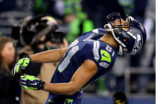 Wide receiver Golden Tate of the Seattle Seahawks celebrates by eating a Skittles after running back Marshawn Lynch scores a 40-yard touchdown during the 2014 NFC Championship in Seattle on Jan. 19