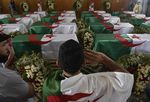 Coffins containing the remains of 24 Algerian resistance fighters are presented at the Palais De La Culture Moufdi Zakaria in Algiers, Algeria, on July 4.