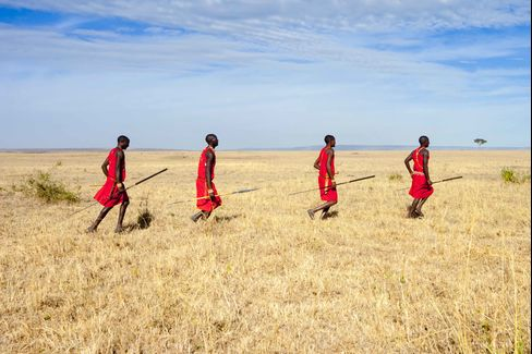 Masai (Maasai), running in the savannah, Olare Orok Conservancy, Masai Mara, Kenya.
