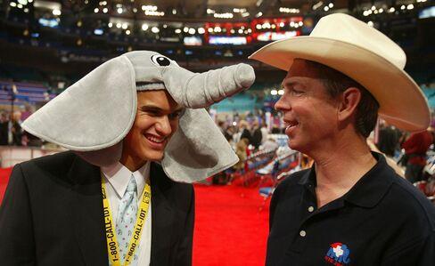 David Barton (R) talks to fellow Texas delegates Josh Kempf at the 2004 Republican National Convention in New York City's Madison Square Garden.