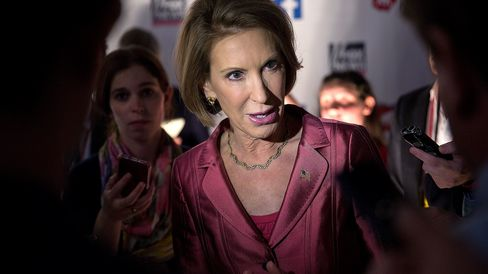 Carly Fiorina, former chairman and chief executive officer of Hewlett-Packard Co. and 2016 Republican presidential candidate, speaks to the media in the spin area after a televised forum ahead of the first Republican presidential debate in Cleveland, Ohio, on Aug. 6, 2015.