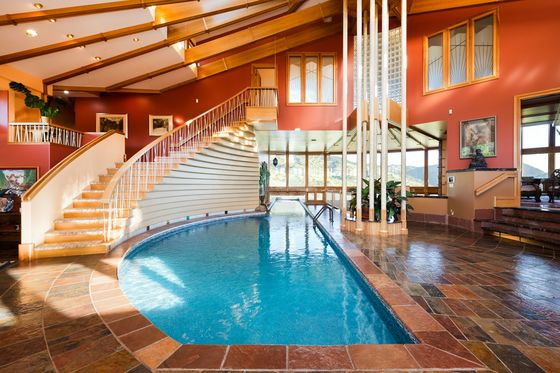 The Mansion That Chunky Monkey Built Has a Pool in the Foyer