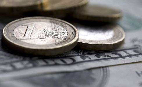 Euro Coins and U.S. Bill