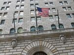 The U.S. flag hangs on the facade of the Federal Reserve Bank of New York headquarters in New York.