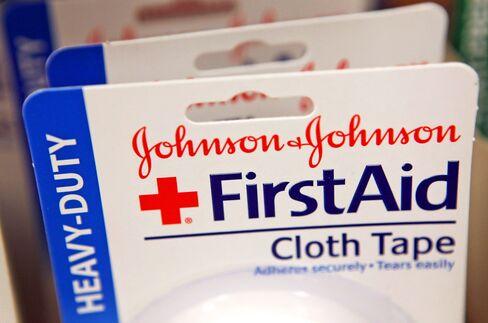 J&J Cuts Forecast After Reporting Drop in Second-Quarter Profit