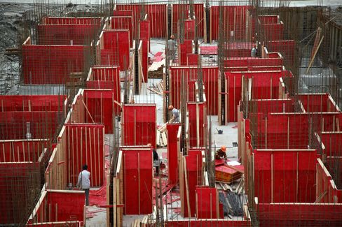 Workers labor on a construction site in Shanghai