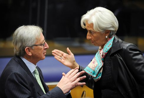 Luxembourg PM Jean-Claude Juncker and IMF Chief Christine Lagar