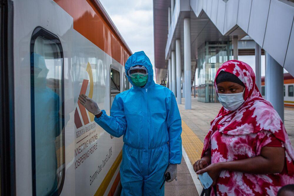 All aboard a Chinese-built-and-operated passenger trainbetween Nairobi and Mombasa, Kenya.