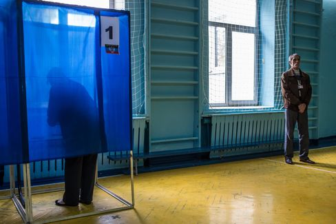A Woman Casts her Ballot at a Polling Station in Hartsizk
