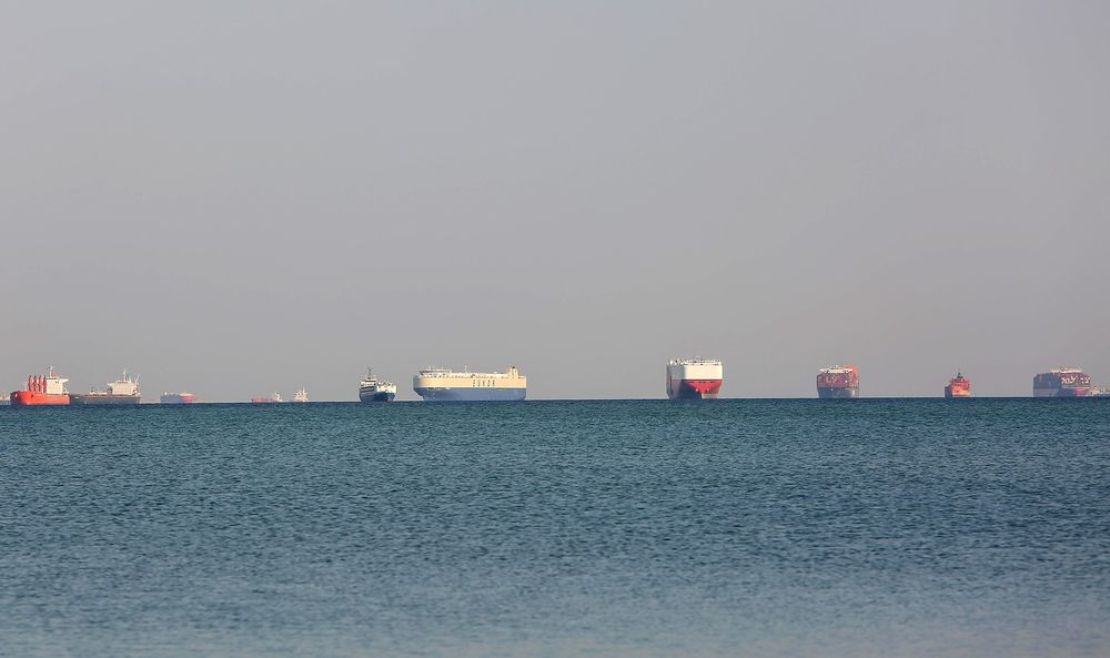 Commercial cargo and container ships ride anchor while waiting to transit the Suez Canal in Ismailia, Egypt, on March 25.