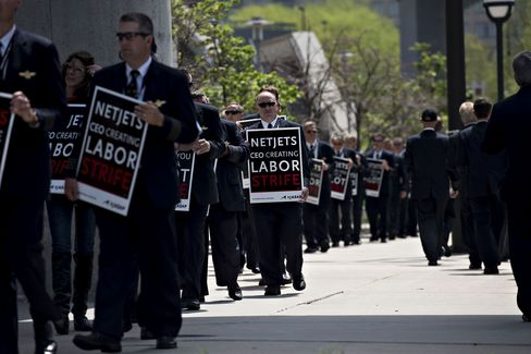 NetJets pilots during a protest outside the Berkshire AGM in Omaha in 2015.