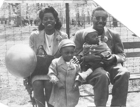 Dorothy and Boyd Mallett with Ron on the left and his younger brother, James, on the right, at the Bronx Park in 1948.