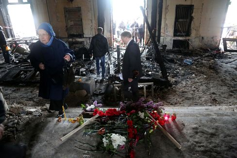 People Walk Inside the Burnt Trade Union Building in Odessa