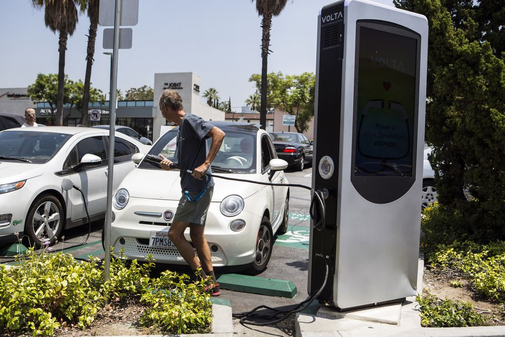 Drivers Charge Electric Vehicles At An Charging Station In Los Angeles California