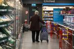 A shopper pulls a trolley along a chilled and frozen goods aisle, during a time set aside for elderly and vulnerable members of the community to shop, at an Iceland Foods Ltd. store in London, U.K.