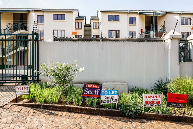 Rental advertisements outside a housing complex in Johannesburg.
