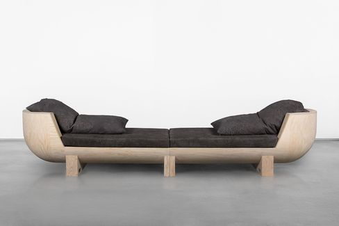 "A ""double bubble"" plywood couch by Rick Owens, which sells for $72,000"