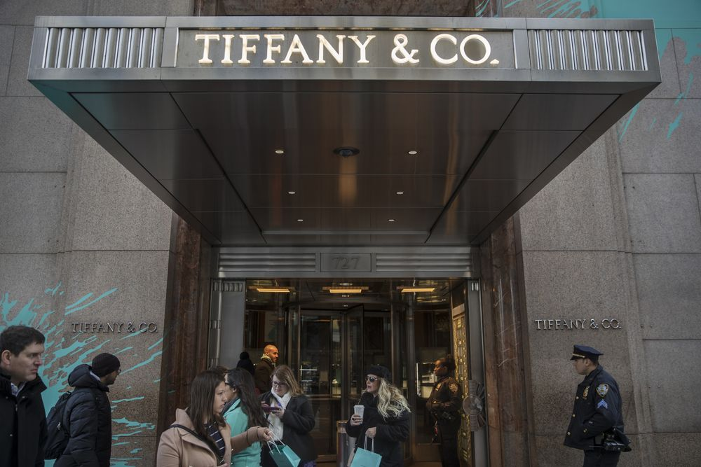8c2ea3e468d8 Shoppers exit the Tiffany   Co. flagship store on Fifth Avenue in New York.