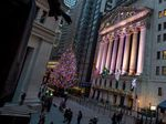 The New York Stock Exchange stands illuminated at night in New York.