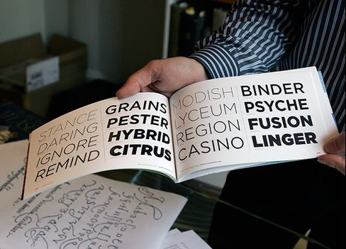 Frere-Jones holds a promotional book in 2007 containing examples of the Gotham typeface