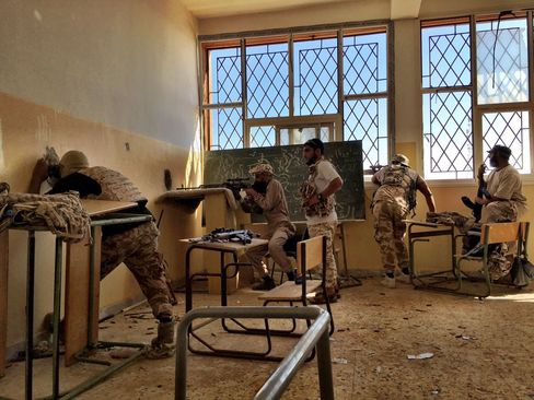 Members of the Misrata-led 604 Brigade operate out of an abandoned school on the frontlines in the battle against Islamic State in Sirte.