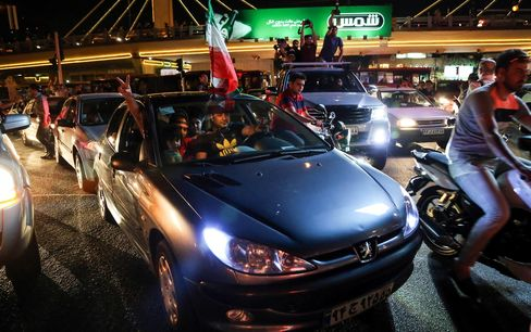 Iranian people celebrate the nuclear agreement in Tehran in July 2015.