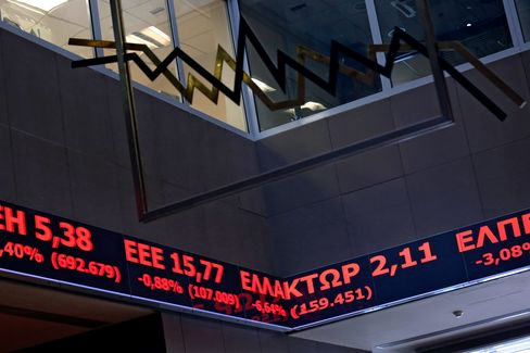 Stock prices pass along a digital ticker screen inside the Hellenic Stock Exchange in Athens.
