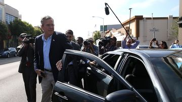 Jeb Bush gets out of an Uber car on July 16, 2015, in San Francisco.