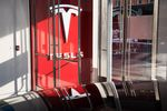 The Tesla Inc. logo hangs on the wall of the entrance to the new Tesla Inc.