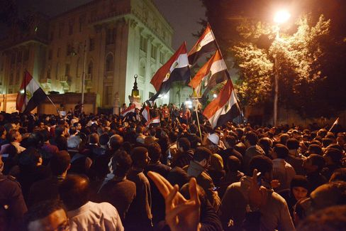 Egyptian Protesters Chanting 'Dictator' Denounce Mursi at Palace