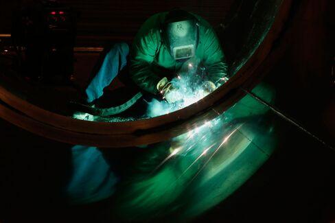 An employee welds the tank of a trailer in Portland, Oregon.