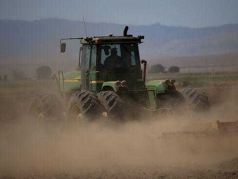 A tractor kicks up dust in Los Banos, California.