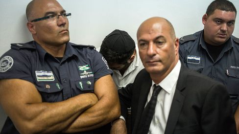 Gery Shalon, center, one of two Israeli men charged in the U.S. in connection with securities fraud.