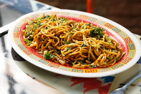 Spicy lo mein noodles with cabbage and greens (you can get it with rotisserie chicken tossed in).