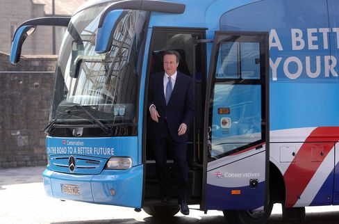 David Cameron, U.K. prime minister and leader of the Conservative Party, steps off of the party's campaign bus as he arrives to unveil the party's 2015 general election manifesto in Swindon, U.K., on April 14, 2015.