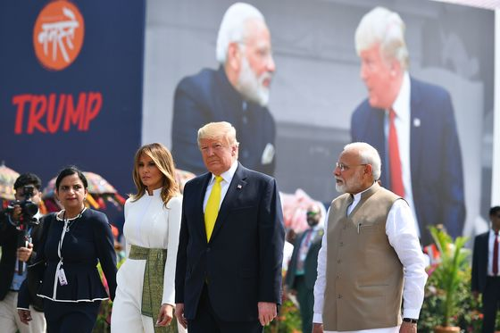 Trump Met by Modi's Promised Pageantry On Arrival in India