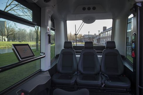 Passenger seating and a touchscreen control panel sit inside a WEpod driverless bus.