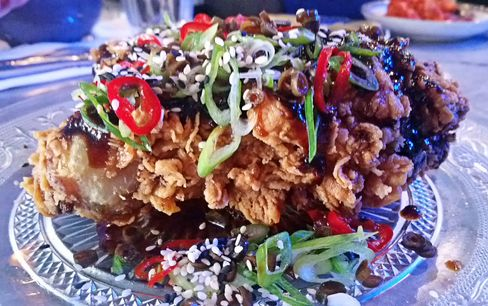 Guest fry: General Tso's glaze, chili, spring onion, sesame seeds and pickled green beans at Chick 'n' Sours.