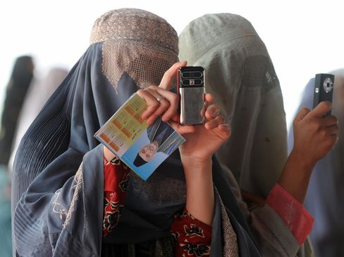Afghan Women Tolerate Beating for Cell Phones in Emerging