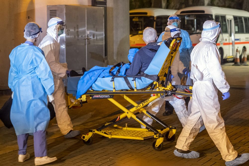 Medical workers transport a suspected coronavirus patient at Queen Mary Hospital in Hong Kong, Jan. 29.