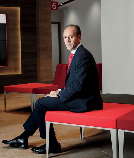 Rami Aboukhair, Santander's Spain country head, visits a newly remodeled branch in Madrid.